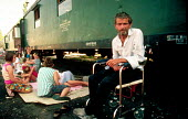 Bosnian Muslim refugees in a makeshift camp in railway carriages. Cakovec, Croatia. 1992 - Howard Davies - 01-08-1992