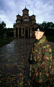 NATO UK forces protect a Serb church against revenge attacks after the war. Gracanica, Kosovo. 1999 - Howard Davies - &,1990s,1999,against,armed forces,army,Balkan,balkans,BAME,BAMEs,belief,BME,bmes,christian,christianity,christians,church,churches,conflict,conflicts,conviction,diversity,ethnic,Ethnic Cleansing,ethni