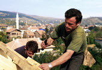 Former KLA combatant on an IOM retraining programme as a builder. Peje, Kosovo. 1999 - Howard Davies - 01-05-1999