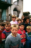 Kosovar Albanian children in a village where forty five men were massacred by Serb forces. Trnje, Kosovo. 1999 - Howard Davies - 01-05-1999