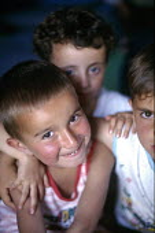 Kosovo Albanian refugee children in their tent, Cegrane camp, Macedonia 1999 - Howard Davies - 01-05-1999