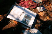 Photo album among the debris after Kosovar Albanian refugees were transited from the border camp. Blace refugee camp, Macedonia - Kosovo border. 1999 - Howard Davies - 1990s,1999,Albanian,Albanians,balkan,balkans,BAME,BAMEs,BME,bmes,border,border control,border controls,borders,camp,camps,CHILD,CHILDHOOD,children,conflict,conflicts,Diaspora,displaced,diversity,EQUAL