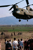 NATO helicopter airlifting supplies to Kosovar Albanian refugees, Stenkovic refugee camp, Macedonia. 1999 - Howard Davies - 01-05-1999
