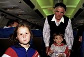 Kosovar Albanian refugees on an IOM/DFID evacuation flight taking them to the UK. 1999 - Howard Davies - 01-05-1999