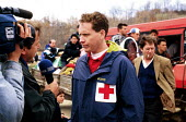Red Cross spokesperson being interviewed by TV crew on Kosovar Albanian refugees living in Blace border camp, Kosovo - Macedonia border. 1999 - Howard Davies - 01-05-1999