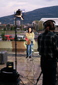TV journalist reporting on exodus of Kosovar Albanian refugees to Blace border camp. Skopje, Macedonia 1999 - Howard Davies - 01-05-1999