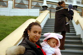 A recently-arrived asylum seeking family, who are living in temporary housing arranged by Migrant Helpline. While they awaits dispersal, to another part of the UK. - Howard Davies - 2000s,2005,adult,adults,and,asylum,Asylum Seeker,Asylum Seeker,babies,baby,BME Black minority ethnic,Bunny,carries,carry,carrying,child,CHILDHOOD,children,Costume,costumes,daughter,daughters,Diaspora,