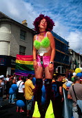Woman on stilts, at the Gay Pride march in Brighton. - Howard Davies - 03-08-2003