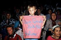 Bosnian Muslim women and children gather for the first anniversary of Srebrenica massacre where more than seven thousand Muslim men were massacred by Bosnian Serbs. Tuzla, Bosnia. 1996 - Howard Davies - 09-10-1996
