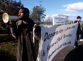 Protests against the detention and deportation of asylum seekers. Taking place outside Tinsley House Immigration Detention Centre close to Gatwick Airport. - Howard Davies - 05-10-2004