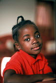 A child from Liberia whose family have resettled in the UK under the UK Governement Gateway Protection Program. The families were identified as being vulnerable during UNHCR protection interviews. She... - Howard Davies - 2000s,2005,africa,african,agencies,agency,aid,aid agency,assistance,BAME,BAMEs,Black,BME,bmes,charitable,charities,charity,child,CHILDHOOD,children,Diaspora,displaced,diversity,ethnic,ethnicity,famili