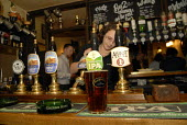 The first pints of Harveys being pulled at the Lewes Arms having being restored to the pub. Locals had led a successful boycott of the pub after Greene King brewery withdrew Harveys when its own beers... - Howard Davies - 26-04-2007