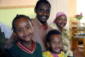 An Oromo family at their new home in Brighton having come to the UK as refugees from Ethiopia under the UK Government Gateway Protection Programme. The family had been identified by UNHCR as vulnerabl... - Howard Davies - 2000s,2007,adult,adults,aid agency,assistance,BAME,BAMEs,Black,BME,BME Black minority ethnic,bmes,boy,boys,camp,camps,child,CHILDHOOD,children,DAD,DADDIES,DADDY,DADS,Diaspora,displaced,diversity,Ethio