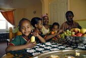 An Oromo family at their new home in Brighton having come to the UK as refugees from Ethiopia under the UK Government Gateway Protection Programme. The family had been identified by UNHCR as vulnerabl... - Howard Davies - 04-03-2007