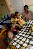 An Oromo family at their new home in Brighton having come to the UK as refugees from Ethiopia under the UK Government Gateway Protection Programme. The family had been identified by UNHCR as vulnerabl... - Howard Davies - ,2000s,2007,adult,adults,aid agency,assistance,BME Black minority ethnic,boy,boys,camp,camps,child,CHILDHOOD,children,DAD,DADDIES,DADDY,DADS,Diaspora,displaced,Ethiopia,families,family,father,FATHERHO