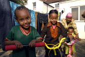 An Oromo family at their new home in Brighton having come to the UK as refugees from Ethiopia under the UK Government Gateway Protection Programme. The family had been identified by UNHCR as vulnerabl... - Howard Davies - 2000s,2007,adult,adults,aid agency,assistance,BAME,BAMEs,Black,BME,BME Black minority ethnic,bmes,boy,boys,camp,camps,child,CHILDHOOD,children,Diaspora,displaced,diversity,Ethiopia,ethnic,ethnicity,fa