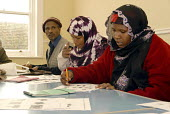 English classes in Brighton for refugees from Ethiopia who came to the UK under the Gateway Protection Programme. The majority of the refugees are Oromo and had been identified by UNHCR as vulnerable... - Howard Davies - 2000s,2007,Adult Education,aid agency,assistance,BAME,BAMEs,bilingual,Black,BME,BME Black minority ethnic,bmes,camp,camps,class,communicating,communication,Diaspora,displaced,diversity,EAL,edu educati