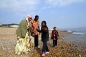 An Oromo family visit the seaside in Brighton having come to the UK as refugees from Ethiopia under the UK Government Gateway Protection Programme. The family had been identified by UNHCR as vulnerabl... - Howard Davies - 2000s,2007,adult,adults,aid agency,assistance,BAME,BAMEs,beech,Black,BME,bmes,boy,boys,camp,camps,child,CHILDHOOD,children,COAST,coastal,coasts,DAD,DADDIES,DADDY,DADS,Diaspora,displaced,diversity,Ethi