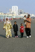An Oromo family visit the seaside in Brighton having come to the UK as refugees from Ethiopia under the UK Government Gateway Protection Programme. The family had been identified by UNHCR as vulnerabl... - Howard Davies - 2000s,2007,aid agency,assistance,BAME,BAMEs,Black,BME,bmes,boy,boys,camp,camps,child,CHILDHOOD,children,COAST,coastal,coasts,DAD,DADDIES,DADDY,DADS,Diaspora,displaced,diversity,Ethiopia,ethnic,ethnici