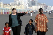 An Oromo family visit the seaside in Brighton with their support worker from Migrant Helpline having come to the UK as refugees from Ethiopia under the UK Government Gateway Protection Programme. The... - Howard Davies - 2000s,2007,aid agency,assistance,BAME,BAMEs,Black,BME,BME black,bmes,boy boys,camp,camps,child,CHILDHOOD,children,COAST,coastal,coasts,Diaspora,displaced,diversity,education,employee,employees,Employm