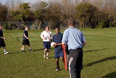 An Oromo refugee, who came to the UK as a refugee from Ethiopia under the Gateway Protection Programme, practices rugby at his secondary school in Brighton, UK 2007 - Howard Davies - 2000s,2007,adolescence,adolescent,adolescents,aid agency,assistance,BAME,BAMEs,Black,BME,bmes,boy,boys,child,CHILDHOOD,children,class,communicating,communication,Diaspora,displaced,diversity,edu educa