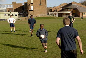 An Oromo refugee, who came to the UK as a refugee from Ethiopia under the Gateway Protection Programme, practices rugby at his secondary school in Brighton, UK 2007 - Howard Davies - 25-03-2007