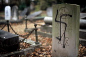 Hate crime. Jewish Graves desecrated with Nazi swastika by far right extremists, Aldershot Jewish cemetery - Howard Davies - 01-01-2004
