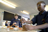 An Oromo refugee, who came to the UK as a refugee from Ethiopia under the Gateway Protection Programme, in a science practical class at his secondary school in Brighton. UK 2007 - Howard Davies - 23-03-2007