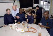 Two students, who came to the UK as refugees from Ethiopia under the Gateway Protection Programme, in a science practical class at their secondary school in Brighton, UK 2007 - Howard Davies - 2000s,2007,aid agency,assistance,BAME,BAMEs,Black,BME,bmes,boy,boys,child,CHILDHOOD,children,class,communicating,communication,Diaspora,displaced,diversity,edu education,education,Ethiopia,ethnic,ethn