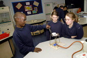Two students, who came to the UK as refugees from Ethiopia under the Gateway Protection Programme, in a science practical class at their secondary school in Brighton, UK 2007 - Howard Davies - 2000s,2007,aid agency,assistance,BAME,BAMEs,Black,BME,bmes,boy,boys,child,CHILDHOOD,children,Diaspora,displaced,diversity,edu education,education,Ethiopia,ethnic,ethnicity,foreign,foreigner,foreigners