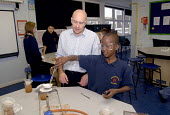 An Oromo refugee, who came to the UK as a refugee from Ethiopia under the Gateway Protection Programme, in a science practical class at his secondary school in Brighton. UK 2007 - Howard Davies - 2000s,2007,aid agency,assistance,BAME,BAMEs,Black,BME,bmes,boy,boys,child,CHILDHOOD,children,class,communicating,communication,Diaspora,displaced,diversity,edu education,education,Ethiopia,ethnic,ethn