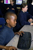 An Oromo refugee, who came to the UK as a refugee from Ethiopia under the Gateway Protection Programme, in an IT class at his secondary school in Brighton, UK 2007 - Howard Davies - 2000s,2007,aid agency,assistance,BAME,BAMEs,Black,BME,bmes,boy,boys,child,CHILDHOOD,children,COMPUTE,computer,computers,COMPUTING,Diaspora,displaced,diversity,edu education,education,Ethiopia,ethnic,e