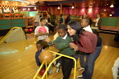 Refugee children, who came to the UK as refugees from Ethiopia under the Gateway Protection Programme, going bowling in Brighton with support workers. The majority of the refugees are Oromo and had be... - Howard Davies - 2000s,2007,aid agency,assistance,BAME,BAMEs,Black,BME,bmes,boy,boys,camp,camps,child,CHILDHOOD,children,Diaspora,displaced,diversity,Ethiopia,ethnic,ethnicity,FEMALE,foreign,foreigner,foreigners,human