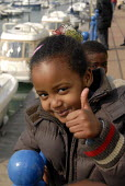 Refugee children, who came to the UK as refugees from Ethiopia under the Gateway Protection Programme, on a visit to Brighton Marina with support workers. The majority of the refugees are Oromo and ha... - Howard Davies - 2000s,2007,aid agency,assistance,BAME,BAMEs,Black,BME,bmes,camp,camps,child,CHILDHOOD,children,Diaspora,displaced,diversity,Ethiopia,ethnic,ethnicity,female,females,foreign,foreigner,foreigners,girl,g