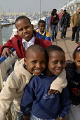 Refugee children, who came to the UK as refugees from Ethiopia under the Gateway Protection Programme, on a visit to Brighton Marina with support workers. The majority of the refugees are Oromo and ha... - Howard Davies - ,2000s,2007,aid agency,assistance,BAME,BAMEs,Black,BME,bmes,boy,boys,camp,camps,child,CHILDHOOD,children,Diaspora,displaced,diversity,Ethiopia,ethnic,ethnicity,foreign,foreigner,foreigners,humanitaria