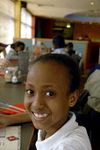 An Oromo refugee, who came to the UK as a refugee from Ethiopia under the Gateway Protection Programme, at her primary school in Brighton, UK 2007 - Howard Davies - 2000s,2007,aid agency,assistance,BAME,BAMEs,Black,BME,bmes,child,CHILDHOOD,children,Diaspora,displaced,diversity,education,Ethiopia,ethnic,ethnicity,female,females,foreign,foreigner,foreigners,girl,gi