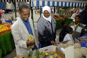 An Oromo family, who came to the UK in 2006 as refugees from Ethiopia under the Gateway Protection Programme, going shopping in a local vegetable market in Brighton. The majority of the refugees are O... - Howard Davies - 2000s,2007,aid agency,assistance,BAME,BAMEs,Black,BME,bmes,bought,buy,buyer,buyers,buying,camp,camps,child,CHILDHOOD,children,commodities,commodity,consumer,consumers,customer,customers,Diaspora,displ