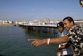Two Oromo refugees, who came to the UK as refugees from Ethiopia under the Gateway Protection Programme, make a visit to Brighton Pier, UK 2007 - Howard Davies - 2000s,2007,aid agency,assistance,BAME,BAMEs,Black,BME,bmes,Diaspora,displaced,diversity,Ethiopia,ethnic,ethnicity,foreign,foreigner,foreigners,humanitarian,immigrant,immigrants,immigration,integration