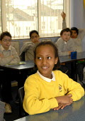 An Oromo refugee, who came to the UK as a refugee from Ethiopia under the Gateway Protection Programme, at her primary school in Brighton, UK 2007 - Howard Davies - 2000s,2007,aid agency,assistance,BAME,BAMEs,Black,BME,bmes,child,CHILDHOOD,children,Diaspora,displaced,diversity,edu education,education,Ethiopia,ethnic,ethnicity,female,females,foreign,foreigner,fore