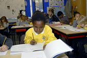 An Oromo refugee, who came to the UK as a refugee from Ethiopia under the Gateway Protection Programme, at her primary school in Brighton, UK 2007 - Howard Davies - ,2000s,2007,aid agency,assistance,BAME,BAMEs,Black,BME,bmes,child,CHILDHOOD,children,Diaspora,displaced,diversity,edu education,education,Ethiopia,ethnic,ethnicity,female,females,foreign,foreigner,for