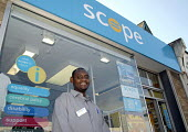 An Oromo refugee, who came to the UK as a refugee from Ethiopia under the Gateway Protection Programme, at the charity shop in Brighton where he is working as a volunteer. UK 2007 - Howard Davies - 03-05-2007