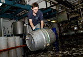 Beer being placed into casks at Harveys Brewery, a family owned business for more than two hundred years. Harveys only sell their bitter within a sixty five mile radius of the brewery in Lewes, UK 200... - Howard Davies - 15-06-2007
