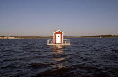 The Utter Inn, a single hotel room designed by artist Mikael Genberg and built three metres under the water surface on Lake Malaren. Guests have glass panels to see out and reach the Inn by boat and h... - Howard Davies - 2000s,2006,ace art arts culture,art,artist,ARTISTS,artwork,artworks,boat,boats,canoe,EBF,Economic,Economy,eu,Europe,european,europeans,Guests,holiday,holidays,hotel,HOTELS,installation,leisure,LFL Lei