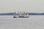 Sailing school on Lake Malaren, Vasteras, Sweden 2006 - Howard Davies - 2000s,2006,boat,boats,dinghies,dingy,eu,Europe,european,europeans,lake,lakes,leisure,LFL Leisure,RECREATION,RECREATIONAL,sailing,Scandinavia,school,SCHOOLS,spo sport sports,sports,Swede,Sweden,Swedes,