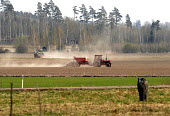 Tractors prepring feilds on a farm in spring time in southern Sweden. 2006 - Howard Davies - ,2000s,2006,AGRICULTURAL,agriculture,capitalism,capitalist,country,countryside,crop,crops,EBF Economy,eu,europe,european,europeans,farm,farm worker,farm workers,farmed,FARMER,farmers,farmhand,farmhand
