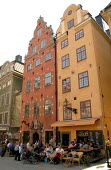 Traditional houses with a cafe below in the Gamla Stan the oldest part of Stockholm, Sweden 2006 - Howard Davies - 2000s,2006,ACE,ace culture,architecture,arts,buildings,cafe,cafes,catering,cities,city,culture,eu,europe,european,europeans,holiday,holidays,houses,leisure,northern,RECREATION,RECREATIONAL,Scandinavia