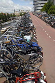 Mass bicycle storage for commuters at Amsterdam Central Station, Holland 2007. - Howard Davies - 2000s,2007,adult,adults,bicycle,bicycles,BICYCLING,Bicyclist,Bicyclists,bike,bikes,cities,city,COMMUTE,commuter,commuters,commuting,cycle,cycles,cycling,Cyclist,Cyclists,dutch,EBF Economy,eni environm