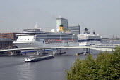 Luxury cruise liners docked on waterfront in Amsterdam, Holland 2007. - Howard Davies - ,2000s,2007,atlantica,boat,boats,costa,cruise,dock,docked,docking,docks,dutch,EBF Economy,elegant,eu,Europe,european,europeans,eurozone,harbor,harbors,HARBOUR,harbours,holiday,holiday maker,holiday ma
