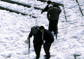 Palestinians negotiating snow laden steps down to the Damascus Gate, East Jerusalem 2003 - Howard Davies - 01-07-2003