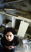 Palestinian child among the rubble of her families house damaged by the Israeli army in the old city of Nablus. West Bank. 2003 - Howard Davies - 2000s,2003,and,arab,arabs,bank,BANKS,CHILD,CHILDHOOD,children,conflict,conflicts,damaged,gaza,house,houses,housing,israel,Israeli,juvenile,juveniles,kid,kids,life,middle east,palestine,palestinian,pal
